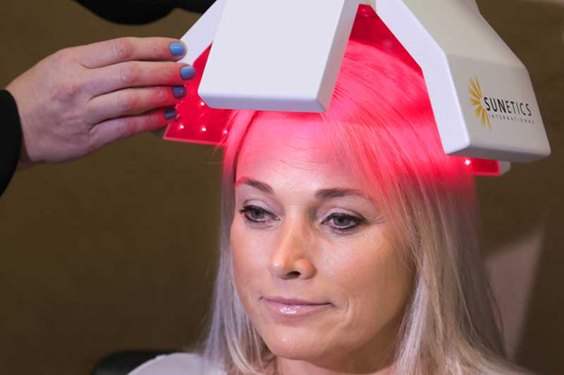 Sunetics Laser light spreading and covering the entire scalp